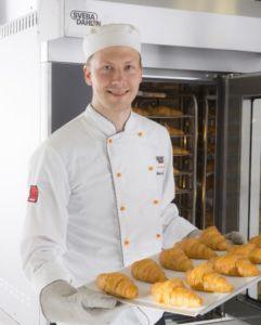 Baker baking croissants using Sveba Dahlen S-series Mini Rack Bakers Oven